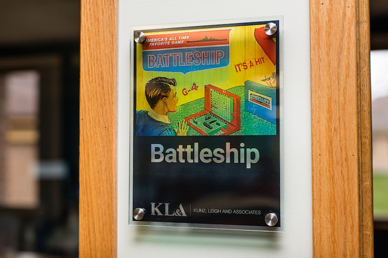 Conference room sign with vintage Battleship game on it
