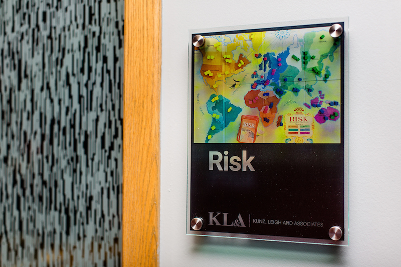 Conference room sign with a picture of a vintage Risk board game
