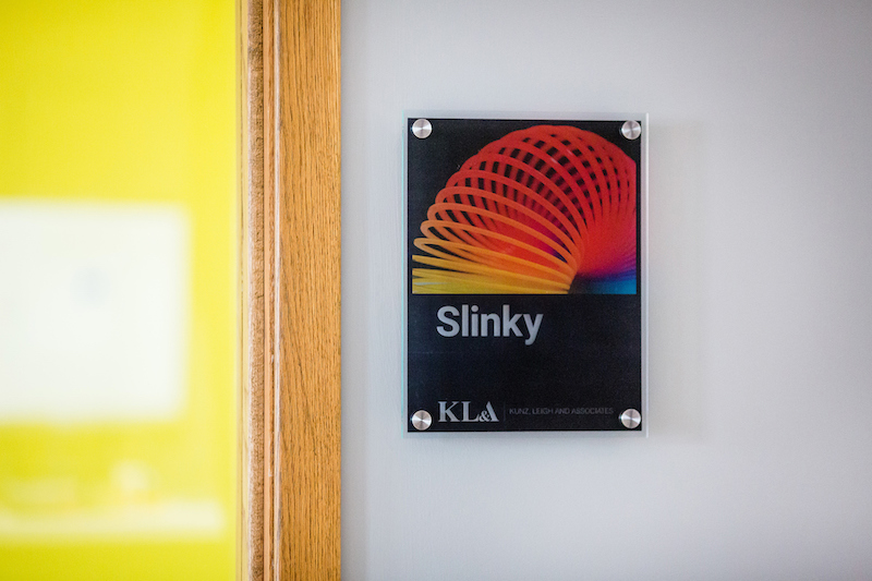 Conference room sign with a slinky on it