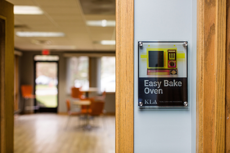 Conference room sign that says Easy Bake Oven with a picture of a vintage easy bake oven toy on it