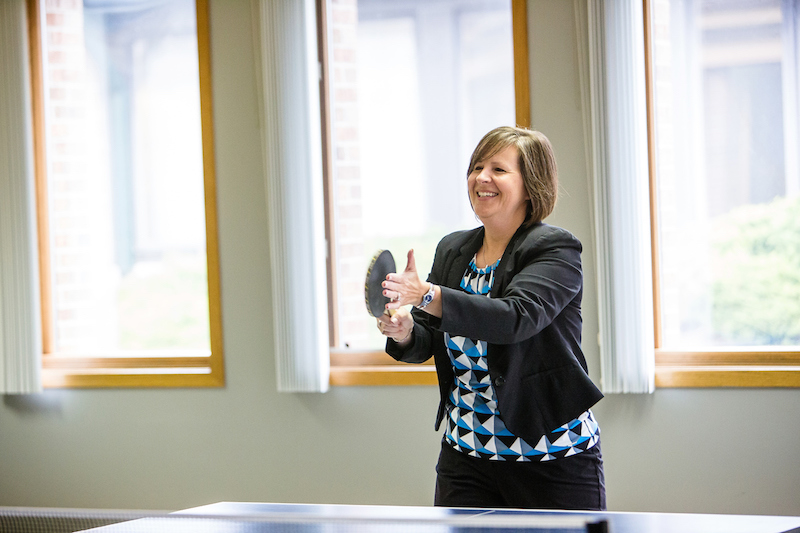 Female employee enjoying a game of ping pong